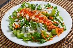 Buffalo Chicken Salad  2 chicken breasts (about a pound)   2 tablespoons hot sauce   salt and pepper   1 tablespoon oil   1 head romaine lettuce (cut into 1 inch thick slices)   2 carrots (shredded)   4 stalks celery (sliced)   2 green onions (sliced)   1/2 cup blue cheese dressing   hot sauce to taste  @Kara Evans