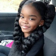 Pretty lil brown girl. Lovely dark skin. Cutest pigtails ever lol! What a smile!