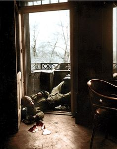 American soldier killed by German snipers on the balcony of a house in Leipzig on April 18, 1945. Photo by Robert Capa