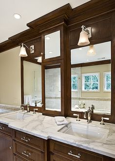 Mirrors set in same cabinet stair with moulding
