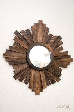 DIY Sunburst Mirror: Upcycle an old mirror into a beachy and rustic piece of home decor using wood slats and Elmer's Glue.