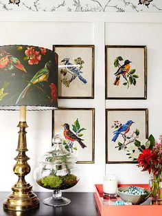 Embroidered Prints framed in a gallery