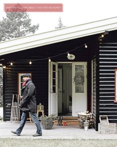 Home Tour: A Festive Scandi Home - love the black exterior and the floorboards
