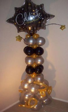 Gray, black and gold Balloon column.  #balloon-column #balloon-decor