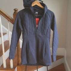 New softest warmest navy blue jacket It pains me to sell this. It is the most comfortable jacket. I can squeeze into it but it is just to small. It is an XS but I think it will fit a small as well . Fleece lined upper body , sleeves and hood. Quilted pattern. Two pockets. High quality design. The North Face Jackets & Coats