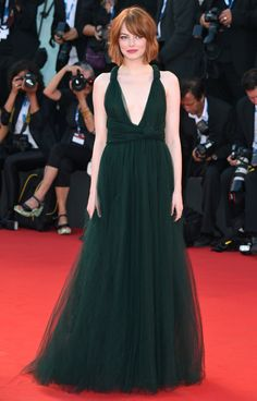 EMMA STONE in a forest green Valentino Haute Coutute gown at the premiere of Birdman in 2014