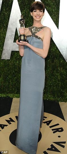 Anne Hathaway looks great at the after party with her Oscar