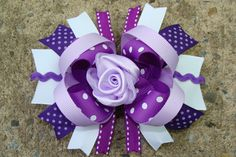 Purple boutique bow with rose center