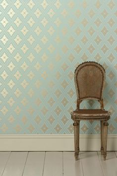 The metallic diamond motif looks extra fresh against the aqua background of this Farrow & Ball Ranelagh Paper ($255 per roll).