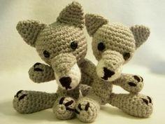 Wolf - Free Amigurumi Pattern here: http://www.craftycattery.com/2008/08/crochet-pattern-amigurumi-wolf.html