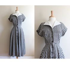 Vintage 1980s does 1950s style black and white gingham plaid linen shirtwaist dress with v -neckline, white collar, fitted bodice, drop shoulder cap sleeves, buttons down the front, waist seam, full midi length skirt, and side seam pockets. Good vintage condition - white collar is a