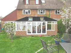LivinRoof Conservatory Project with Sliding Patio Doors | Cousins Conservatories & Garden Buildings