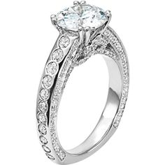 Diamond engagement ring with round center stone, burnished diamond band and pave diamond floral side treatment from Diana.