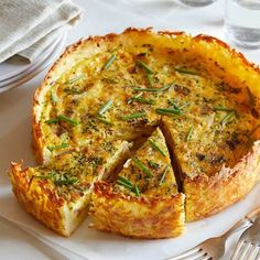 A recipe for Bacon, Onion and Chive Quiche with a Hash Brown Crust by Spoon Fork Bacon. - potatoes, cheese, eggs, cream, onion, etc. good, want! lj