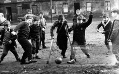 Classic Collection, Page 32, 10379947, Gorbals, Glasgow, 27th December 1967, A group of boys, one with crutches, playing football in the street