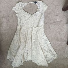 Gorgeous Lace American Eagle Dress Gorgeous all over lace dress from AEO. This dress is fit and flare style with cap sleeves and a hanky style hem. The hem is also a raw edge hem. There is a built in cotton slip underneath for coverage. Worn maybe once or twice. Color is a cream color. Runs small. American Eagle Outfitters Dresses