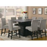 Found it at Wayfair - Brownville 9 Piece Counter Height Dining Set  $1450 for 8 chairs and table.  Also offered is a rectangle for $577 and table height chairs.