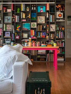stellar shelf styling and incredible pop of hot pink in this home office that also looks like it's in the living room.