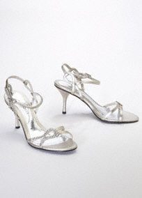 """Step out in style withthis sleek metallic sandal!  Metallic high heel features anintricateswirl rhinestone pattern that is flawless.  Quarter strap with side adjustable closure.  3 1/2"""" heel. Imported."""