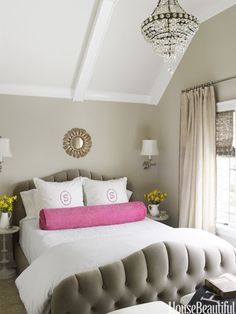 Neutral bedroom with a pop of color. Design: Kelie Grosso. Photo: Ngoc Minh Ngo. housebeautiful.com #bedroom #pink #gray #tufted_headboard #chandelier
