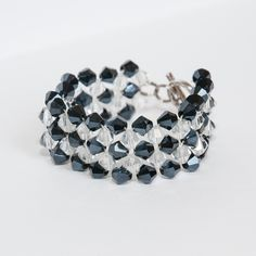 Made from 6mm glass bicones and crystal string with circle clamp.
