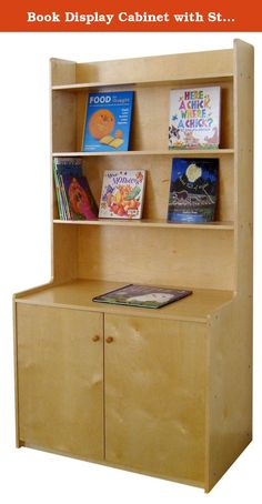 Book Display Cabinet with Storage. G8033 Features: -Material: Plywood. -Durable and sturdy. -Storage of larger items. -For use in schools, daycares or homes. Product Type: -Bookcase. Finish: -Beige birch. Back Panel: -Closed back. Solid Wood Construction: -Yes. Installation Type: -Free standing. Orientation: -Vertical. Primary Material: -Wood. Country of Manufacture: -China. Double-Sided: -Yes. Number of Items Included: -1. Commercial Use: -Yes. Eco-Friendly: -Yes. Number of Tiers: -4....