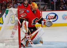 CALGARY, AB - DECEMBER 2: David Rittich #33 of the Calgary Flames comes in relief of Mike Smith #41 against the Edmonton Oilers at Scotiabank Saddledome on December 2, 2017 in Calgary, Alberta, Canada. (Photo by Gerry Thomas/NHLI via Getty Images)