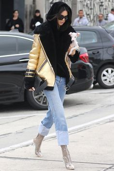 Kendall Jenner in a sheepskin coat Acne Studios, hoodie House of Sunny, Levi's jeans and boots Ego in West Hollywood