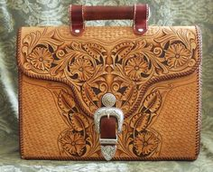 """Here's a beautiful ( yet rugged) briefcase carved and tooled in the Sheridan style. Made from 8-9 oz veg tan leather, with a gorgeous western style buckle set. 17""""x13""""x5"""". Unlined. $650. +shippin..."""