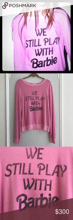 """✨PRICE DROP✨Wildfox We Still Play With Barbie BBJ ✨RARE FIND✨COLLECTORS PIECE✨  I LOVE THIS BBJ! I have a little girl, and we do in fact, still play with Barbie  EUC!! Measures approx 20"""" across bust and 26.5"""" L. It's the BAGGY BJ.. its awesome. Barbie 2014 resort collection! Dream house pink!  Wildfox Tops Sweatshirts & Hoodies"""