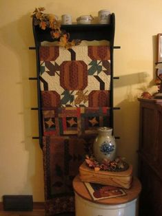 Love the quilts. But especially love the display rack/shelf!!