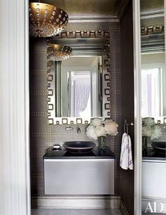 A French light fixture hangs in the stylish powder room of a Susanna Maggard Interiors–designed Manhattan apartment in the Plaza Hotel. The 1960s Italian mirror is by Gabriella Crespi.