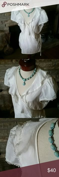 GAP Beautiful Lace Blouse Size XL New with tags! Beautiful Lace detail in wrap tie blouse. Short sleeve woth pllave,detail throughout all seams. Rayon cotton blend. Lace 100% cotton. New with tags. Ties at waist. GAP Tops