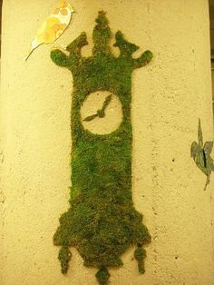 I'd like a moss-graffiti clock in my garden one day......