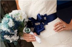 What are the blue/turquoise flowery things in this bouquet?