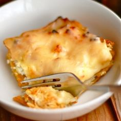 Butternut Squash Lasagna: ricotta cheese, butternut squash, parmesan, whole wheat lasagna, and topped with a slice of gouda cheese!