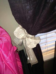 Thirty one scarf used to tie back curtain