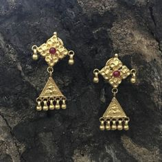 Product Details: Base Material - 92.5 Carat Pure Silver with Gold Plating Technique - Handcrafted Product Type - Temple Jewellery  Design - Dangler  Length - 5 cm  Width - 3 cm  Care Instructions - Avoid Contact with Perfumes and Water Contact No - +91 8095752326 E-Mail - contactus@madhurya.com  Also available in Pure Gold*  Shipping Worldwide
