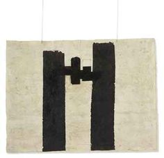Eduardo Chillida (1924-2002), Gravitación (untitled/number not known), 1988. Cut handmade paper, black ink and string. 59.1cm H x 79.4cm W.