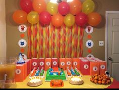 Daniel Tiger decorations. Streamers and balloons with cut out images of Daniel tiger characters from pbs.org