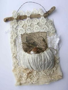 A little bird in a silk pocket - fabric collage. Driftwood and wire as hanger