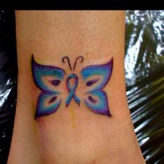 PCOS tattoo the color is off a little.