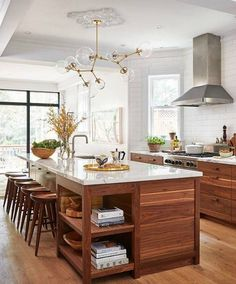 love the wood cabinets, perhaps with white floors, unifying brass elements