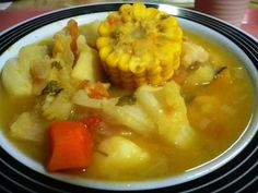 Sancocho de Gallina, a rich, robust, rustic version of homemade chicken soup. This South American version includes corn on the cob, yucca root, cilantro, free-range chicken, and other tropical tubers and seasonings. Caribbean cooks typically color the soup a yellowish color with a special spice that gives off a strong reddish/yellow color. It's almost like saffron, but not really.