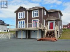 152 SUMMIT Drive Paradise Newfoundland (1125819) | Spacious Kitchen with an abundance of cabinets and large center island with Granite Countertops and featuring all new stainless steel appliances. For more info contact Wally Lane (709) 764-3363 wally@normanlane.ca