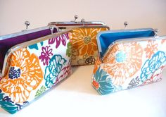 Fun floral clutch set of 3 on Etsy! Orange, blue, and magenta bridesmaid clutches  https://www.etsy.com/listing/249806123/fall-bridesmaid-clutch-set-of-3-floral