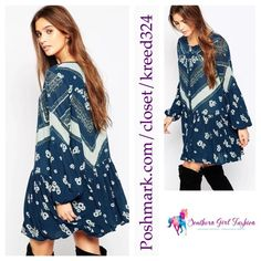 """FREE PEOPLE Tunic Printed Long Sleeve Mini Dress Size XS. New with tags.  $128 Retail + Tax.  Printed blue long sleeve smocked mini dress with button closure and hop pockets. Sheer, unlined, rayon.   Measurements for XS: Bust: 42"""" Waist: 52"""" Sleeve: 25"""" Length: 33.5""""   ❗️ Please - no trades, PP, holds, or Modeling.    Bundle 2+ items for a 20% discount!    Stop by my closet for even more items from this brand!  ✔️ Items are priced to sell, however reasonable offers will be considered when…"""
