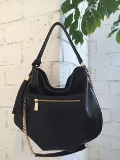 Echo's of the 70's made modern. Key shape of the season and trending strongly into next year. The hobo bag in two sizes and colors with shoulder and cross body straps in a luscious vegan pebble leather irresistible http://www.88-eightyeight.com/