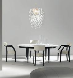 NEOZ by Philippe Starck 1996 Solid ebonized mahogany structure with cast-aluminum leg terminals and nylon castors. Calacatta Carrara white marble or mahogany top.*