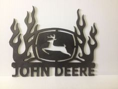 """Featuring """"Nothing runs like a Deere"""" in yellow text on green with a traditional John Deere logo to the left. Nothing Runs Like a Deere Tin Sign. Give your farmhouse a special touch with Green & Yellow Nothing Runs Like a Deere Tin Sign. Metal Art Projects, Welding Projects, Metal Artwork, Metal Wall Art, John Deere Crafts, Plasma Cutter Art, Man Cave Art, Popular Crafts, Plasma Cutting"""